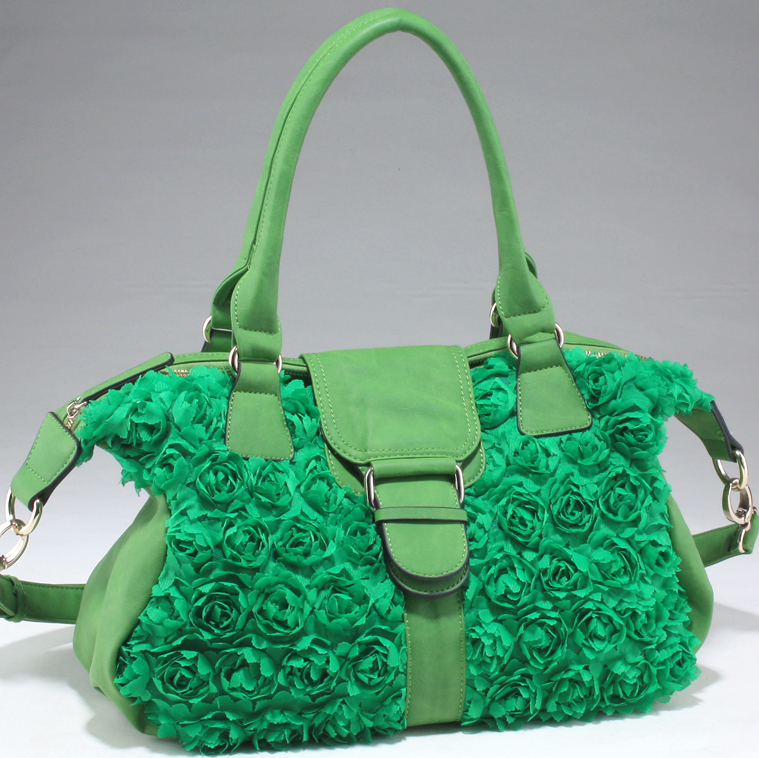 Decorative rosette shoulder bag with flap over magnetic snap closure